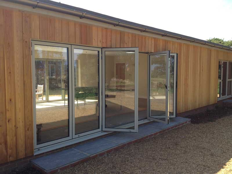 RAL 7032 Bi folding Aluminium doors in North Norfolk