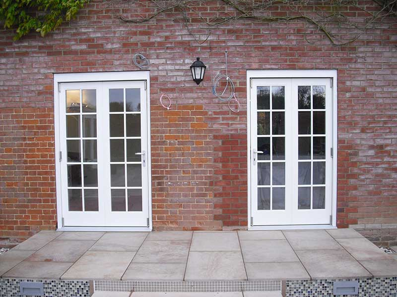Hardwood two part Bi fold doors in Barham Broom
