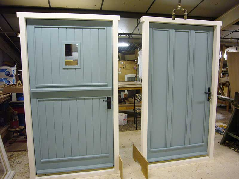 Bespoke Green hardwood doors at our factory in Norwich