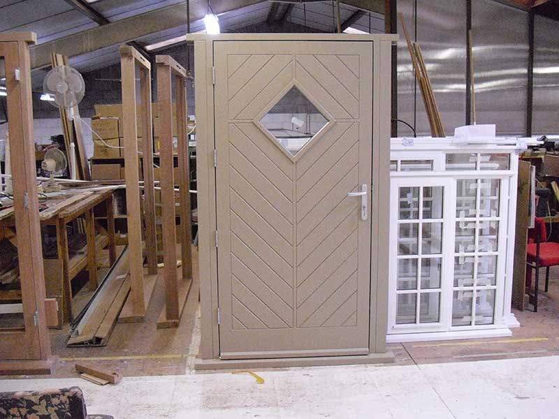 Mushroom colour Hardwood door at our factory in Norwich