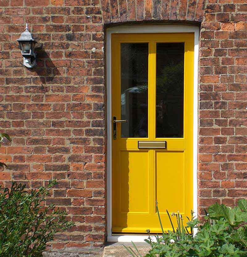 Yellow hardwood door in North Norfolk