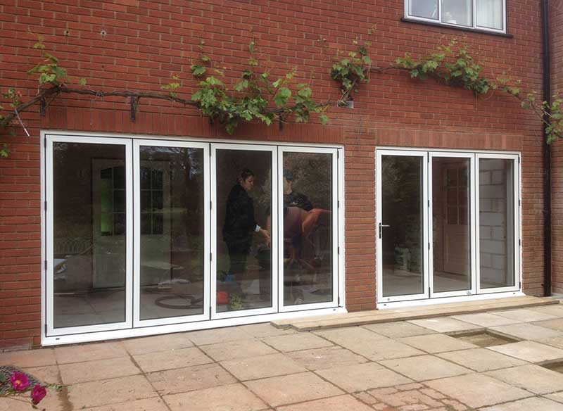 White aluminium Bi folding doors in Marlingford