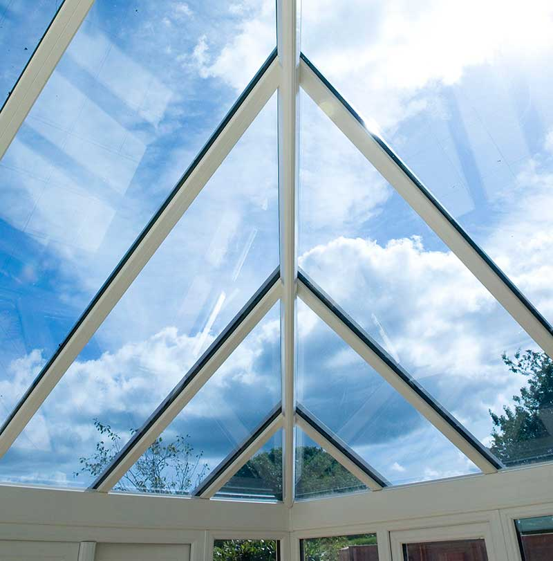 Blue Tint glass roof inside view into skyline, roof in Surlingham