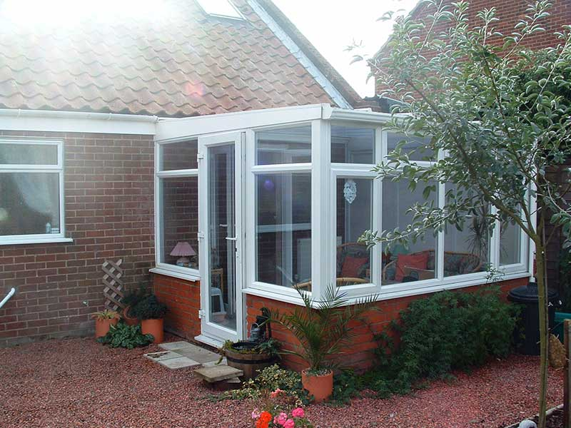 White PVCu lean to conservatory in Alysham