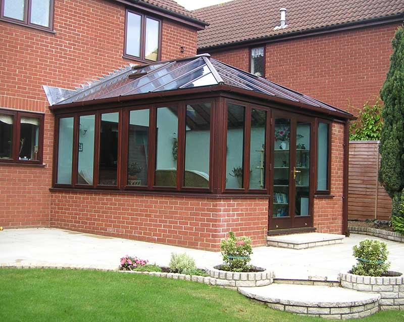 Mahogany Hardwood conservatory with blue Glass Roof in Thorpe