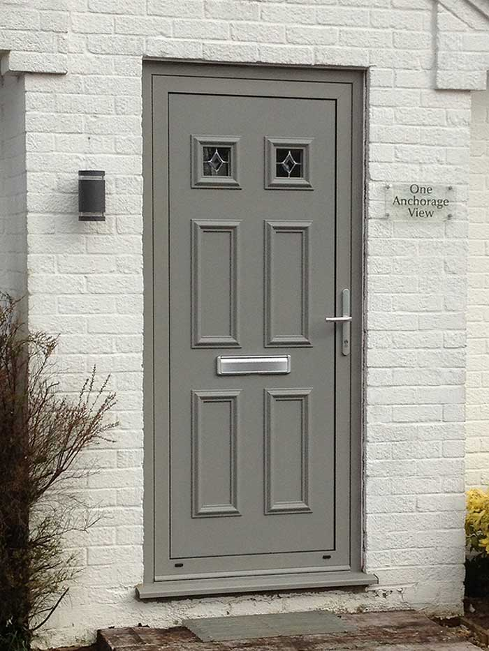 Aluminium Alitherm+ door with colour matched feature panel in Brancaster