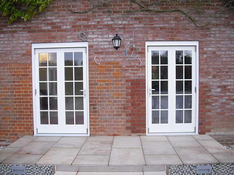 Hardwood two part Bi fold doors in Barham Broom