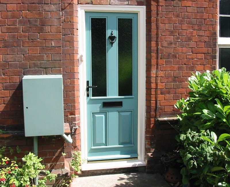 Green door with black hardware in Cromer
