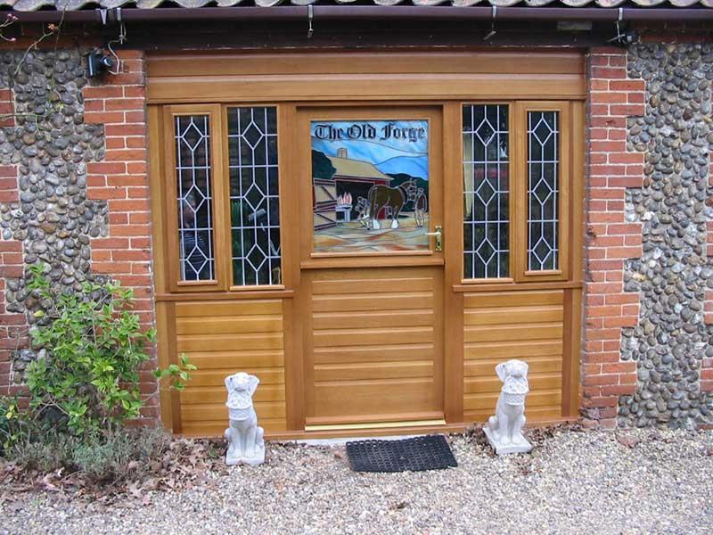 Light oak door with shiplap panels in Fakenham