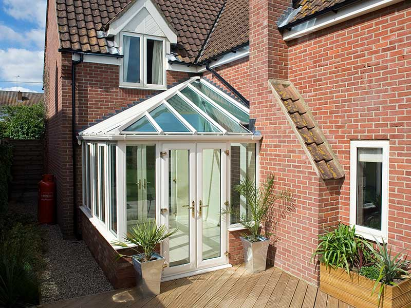 White Hipped roof conservatory – Blue tint Glass roof in Surlingham