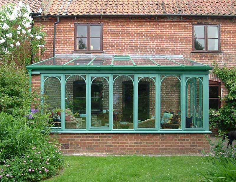Green Hardwood Conservatory with plant on arches in North Walsham