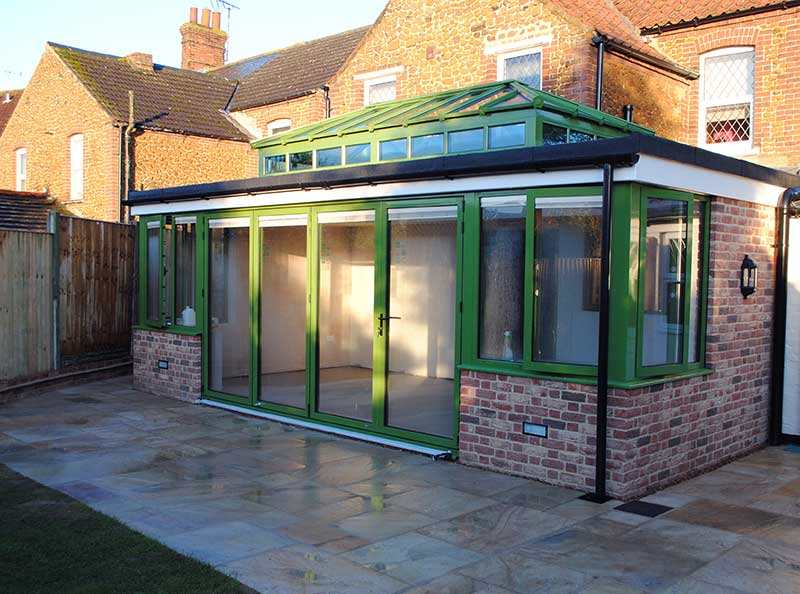 RAL 6025 Green Flat roof Extension with Glass Lantern and Bi Fold Doors